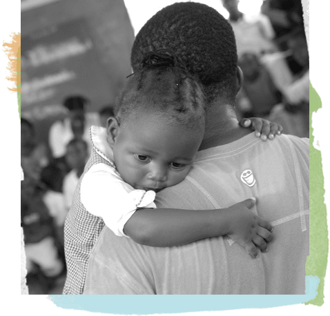 young man embracing a child over his shoulder